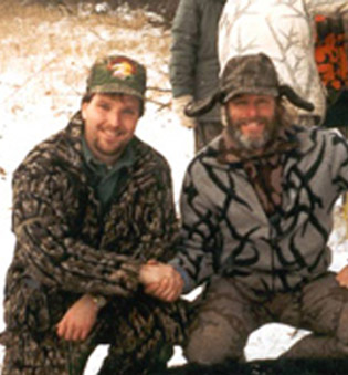 Buck Magic owner, Mark Perry, kneeling with Ted Nugent